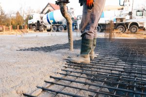 Concrete worker laying a foundation for a business in Johnson City